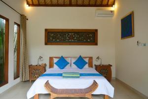 Cama ou camas em um quarto em Villa Mewali