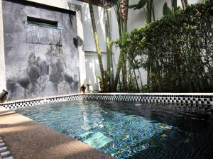 The swimming pool at or near Coconut Grove Boutique Residence by Chattha