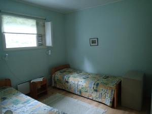 A bed or beds in a room at Villa Berta