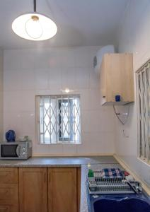 A kitchen or kitchenette at Royal German Apartments
