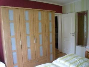 """Ein Bett oder Betten in einem Zimmer der Unterkunft Ferienwohnung """"Abendröte"""""""