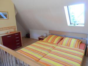 Ein Bett oder Betten in einem Zimmer der Unterkunft Rothers Ferienwohnung