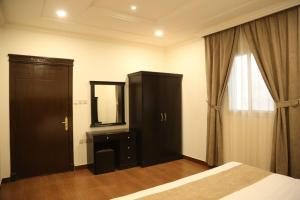 A television and/or entertainment center at Sama Al Nakheel Furnished Apartments-Families only
