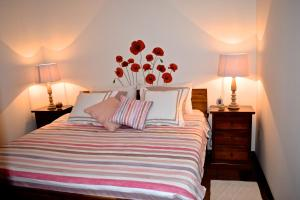 A bed or beds in a room at Apartments Loreta