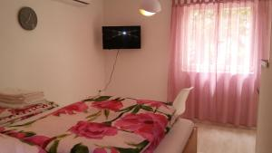 A bed or beds in a room at Ivana Apartment