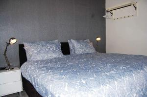 A bed or beds in a room at South King Apartment