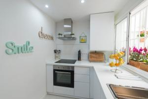 A kitchen or kitchenette at Anjara Apartments