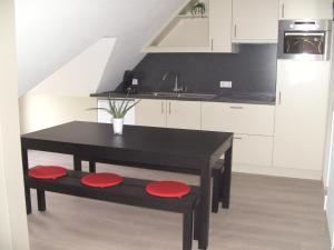A kitchen or kitchenette at 't Vossenerf