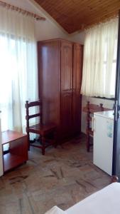 TV o dispositivi per l'intrattenimento presso Akis Apartments