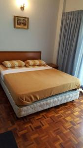 A bed or beds in a room at Anba@Bougainvilla Apartment