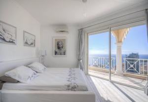 Ein Bett oder Betten in einem Zimmer der Unterkunft Villa MARìNE