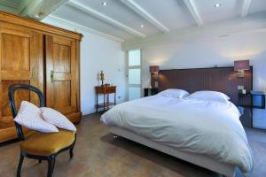 Ein Bett oder Betten in einem Zimmer der Unterkunft Suites Residences Spa