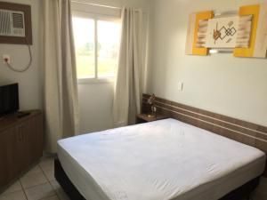 A bed or beds in a room at Apartamento Ecologic Park Caldas Novas