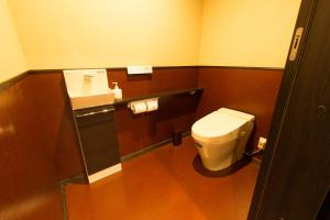 A bathroom at MUSUBI HOTEL Kyoto Sanjo Villa