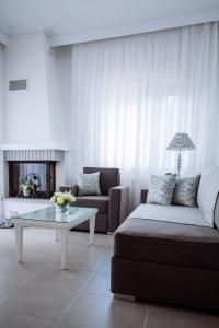 Een zitgedeelte bij Villa Kiza Apartments