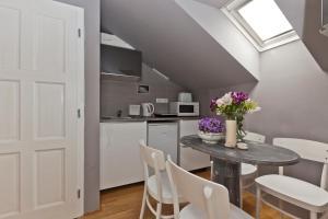 A cozinha ou cozinha compacta de Royal Prague City Apartments