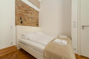 A bed or beds in a room at Tatra 4 Studios