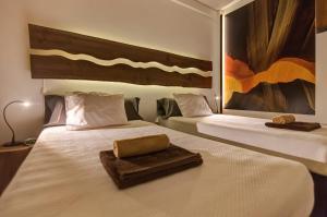 Giường trong phòng chung tại epicenter SANTACRUZ