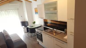 A kitchen or kitchenette at Apartments Klelija