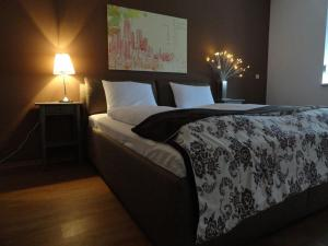 A bed or beds in a room at Apartmány Gulliver