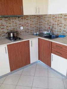 A kitchen or kitchenette at Mariana Apartments