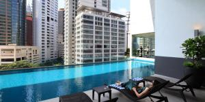 The swimming pool at or near One Bukit Ceylon by Homes Asian