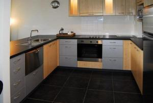 A kitchen or kitchenette at Waves Apartments