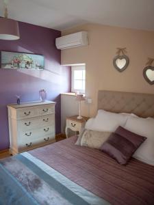 Un ou plusieurs lits dans un hébergement de l'établissement Le Petit Nid***