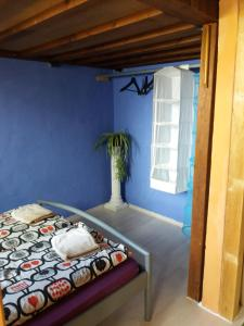 A bed or beds in a room at High Sky Apartment