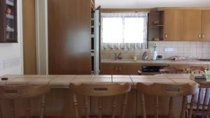 A kitchen or kitchenette at George Vacation Home
