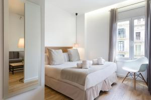A bed or beds in a room at Amister Apartments