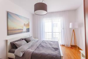 A bed or beds in a room at Family Apartments Vidikovac