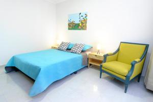 A bed or beds in a room at Casa Bogotana
