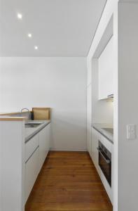 A kitchen or kitchenette at Casas do Rivoli