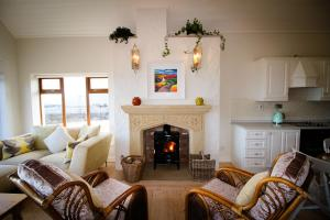 A seating area at Salt Cliff Cottage