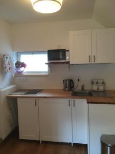 A kitchen or kitchenette at House Apartmentshumpolec + Garden