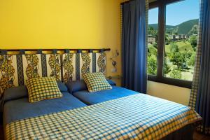 A bed or beds in a room at Apartaments Sant Bernat