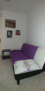A bed or beds in a room at Adeola