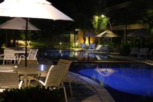 The swimming pool at or near Nannai Flat Duplex Muro Alto