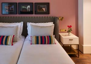 A bed or beds in a room at The Lumiares Hotel & Spa - Small Luxury Hotels Of The World