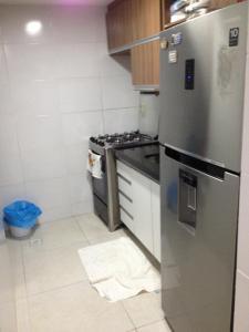 A kitchen or kitchenette at Apartamento Edifício Bom Vivant