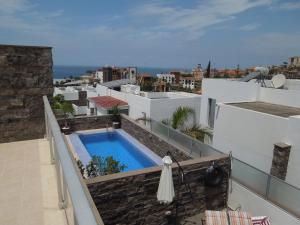 A view of the pool at Villa El Duque or nearby