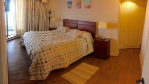 A bed or beds in a room at San Alfonso del Mar Resort
