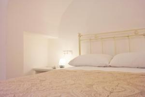 Ένα ή περισσότερα κρεβάτια σε δωμάτιο στο Katerina Suites