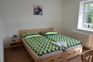 Postel nebo postele na pokoji v ubytování Penzion Havelka
