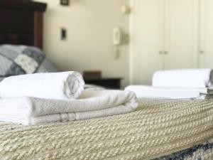 Cama o camas de una habitación en El Cosmopolita Apartment