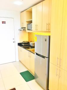 A kitchen or kitchenette at JT Suites Tagaytay @ SMDC Wind Residences