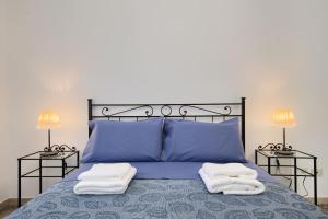 A bed or beds in a room at Appartamento turistico di Lulù