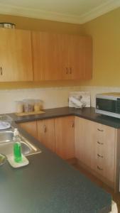 A kitchen or kitchenette at Mahanaim Cottage