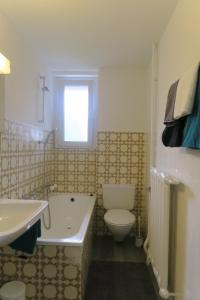 A bathroom at Zurich Furnished Apartments
